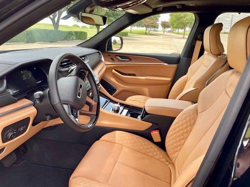 2021-Jeep-Grand-Cherokee-L-Summit-Reserve-front-seats-carprousa